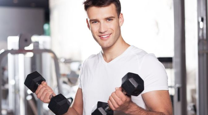14336797 - man exercising with dumbbells