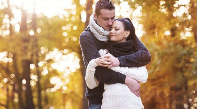 47409013 - beautiful couple in love on a walk in autumn forest