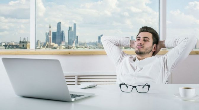 60737590 - young european businessman relaxing in modern bright office room with city view