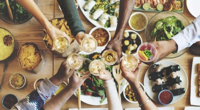 54710749 - friends happiness enjoying dinning eating concept