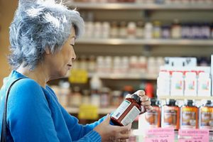 Woman-Senior-Asian-with-bottle